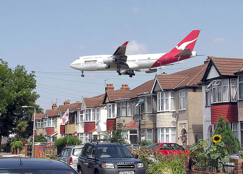 Aircraft over houses needing triple glazing